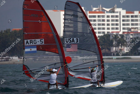 Argentina's Jazmin Lopez, left, and Farrah Hall of the United States sail in the Pan American Games final RS-X Femenil sailing event in Puerto Vallarta, Mexico