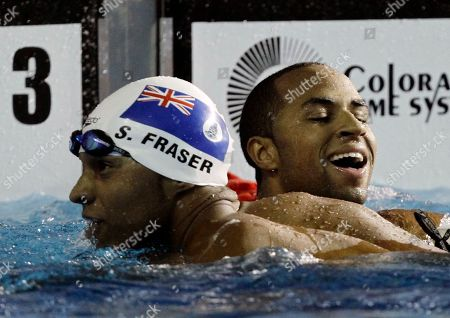 Cayman Island's Brett Fraser, right, celebrates next to his brother Shaune after winning the men's swimming 200m freestyle at the Pan American Games in Guadalajara, Mexico, . Brett won gold and Shaune silver