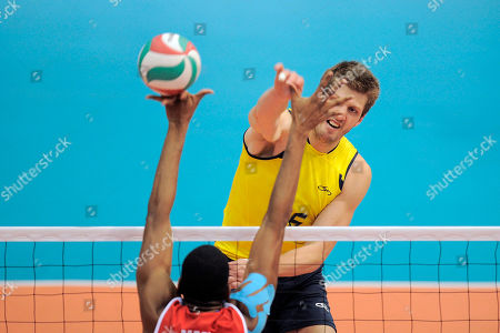 Eder Carbonera from Brazil spikes the ball against Cuba during the men's volleyball match for the gold medal at the Pan American Games in Guadalajara, Mexico