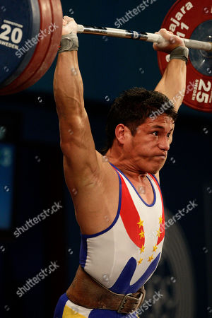 Stock Picture of Venezuela's Junior Sanchez holds up 170 kg in the clean and jerk of the men's 69 kg weightlifting competition at the Pan American Games in Guadalajara, Mexico, . Sanchez won the silver medal