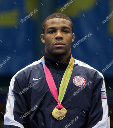 Jordan Burroughs, of the United States, poses wearing his wrestling gold medal during ceremonies at the Pan American Games in Guadalajara, Mexico. The U.S. is hoping for a strong showing from youngsters like Jordan Burroughs and Jake Varner as it eyes a better performance at the London Games than the lone gold medal it earned in Beijing four years ago