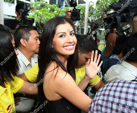 Stock Picture of Shamcey Supsup Shamcey Supsup, who placed 3rd runner-up in the 2011 Miss Universe beauty pageant held in Sao Paulo, Brazil last week, smiles as she is escorted to her limousine upon arrival from Los Angeles early at the Ninoy Aquino International Airport in Manila, Philippines
