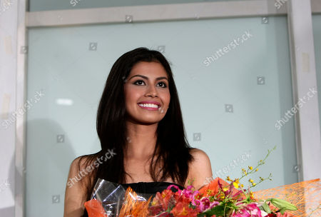 Shamcey Supsup Filipino beauty Shamcey Supsup, who placed 3rd runner-up in the 2011 Miss Universe beauty pageant held in Sao Paulo, Brazil last week, holds a bouquet of flowers upon arrival from Los Angeles early Sunday Sept.18, 2011 at the Ninoy Aquino International Airport in Manila, Philippines. Miss Angola, Leila Lopes, was crowned the 2011 Miss Universe