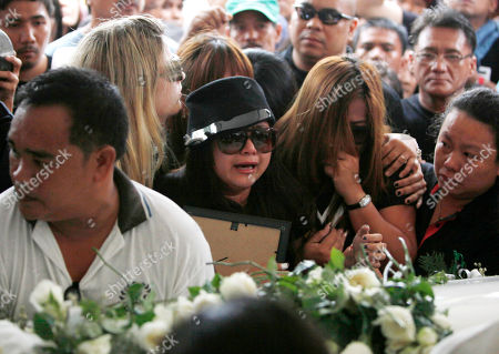 """Charice Pempengco, Raquel Pempengco Filipino singer Charice Pempengco, third from right, of the TV hit """"Glee"""", cries during interment of her estranged father Ricky Pempengco at a memorial park at Cabuyao township, Laguna province south of Manila, Philippines. Ricky Pempengco was stabbed to death in nearby San Pedro township early this week by Angel Capili Jr. who later surrendered to police and admitted his crime. Second from right is Charice's mother Raquel"""