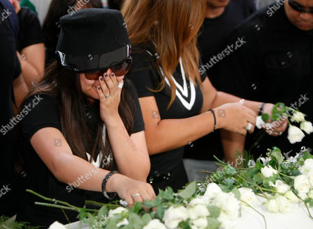 """Charice Pempengco Filipino singer Charice Pempengco, left, of the TV hit """"Glee"""", places white roses on the coffin of her estranged father Ricky Pempengco during interment at a memorial park at Cabuyao township, Laguna province south of Manila, Philippines. Ricky Pempengco was stabbed to death in nearby San Pedro township early this week by Angel Capili Jr. who later surrendered to police and admitted his crime"""
