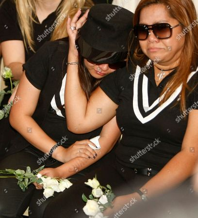 """Charice Pempengco, Raquel Pempengco Filipino singer Charice Pempengco, left, of the TV hit """"Glee"""", leans over the shoulder of her mother Raquel during interment of her estranged father Ricky Pempengco at a memorial park at Cabuyao township, Laguna province, south of Manila, Philippines. Ricky Pempengco was stabbed to death in nearby San Pedro township early this week by Angel Capili Jr. who later surrendered to police and admitted his crime"""