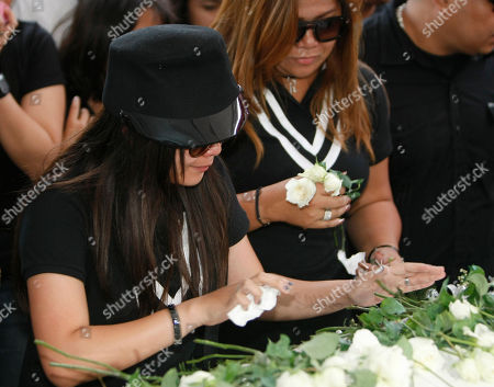 """Charice Pempengco, Raquel Pempengco Filipino singer Charice Pempengco, left, of the TV hit """"Glee"""", touches the coffin of her estranged father Ricky Pempengco prior to interment at a memorial park at Cabuyao township, Laguna province, south of Manila, Philippines. Ricky Pempengco was stabbed to death in nearby San Pedro township early this week by Angel Capili Jr. who later surrendered to police and admitted his crime. At right is Charice's mother Raquel"""