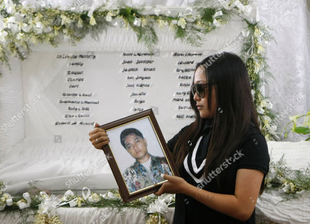 """Charice Pempengco Filipino singer Charice Pempengco of the TV hit """"Glee"""", holds a portrait of her estranged father Ricky Pempengco during a memorial service at a funeral home at Muntinlupa city, south of Manila, Philippines. Ricky Pempengco was stabbed to death in nearby San Pedro township early this week by Angel Capili Jr. who later surrendered to police and admitted his crime"""