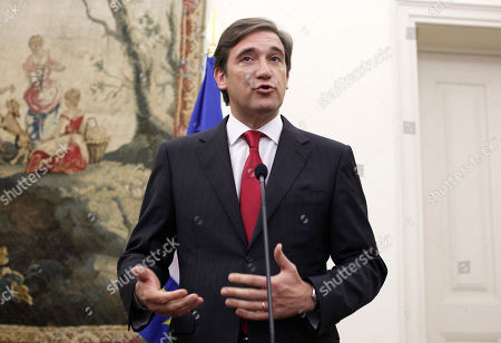 Pedro Passos Coelho Portugal's Prime Minister Pedro Passos Coelho speaks during a news conference with his Cape Verde's counterpart Jose Maria Neves, unseen, at the premier's official resident Sao Bento Palace in Lisbon, . The European Central Bank cut back its government bond purchases to only 3.95 billion euros ($5.3 billion) last week, slowing the program that is keeping the debt crisis from dragging down more countries. High interest rates have already driven Greece, Ireland and Portugal to seek bailouts from their fellow eurozone governments