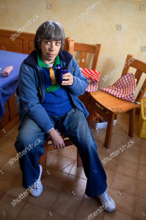 Maria do Rosario Valente, wife of captured American fugitive George Wright, drinks a cup of tea in the kitchen of their house following an interview, in Almocageme, outside Lisbon. Valente told The Associated Press that her husband regrets his criminal past, including his 1962 New Jersey murder conviction, escape from a U.S. prison and hijacking of a plane in 1972. Wright, 68, was on the run for 41 years until his arrest in Portugal a month ago and is currently under house arrest