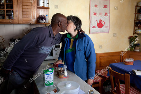 Captured American fugitive George Wright kisses his wife Maria do Rosario Valente in the kitchen of their house, in Almocageme, outside Lisbon. Valente says in an interview with The Associated Press that her husband regrets his criminal past, including his 1962 New Jersey murder conviction, escape from a U.S. prison and hijacking of a plane in 1972. Wright, 68, was on the run for 41 years until his arrest in Portugal a month ago and is currently under house arrest