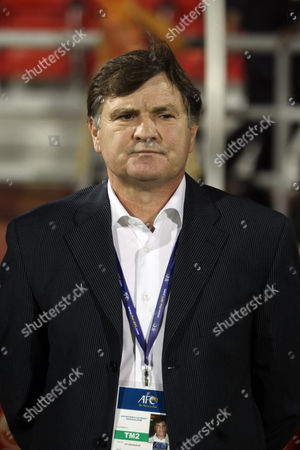 China's head coach Jose Antonio Camacho of Spain watches their match against Iraq in the 2014 FIFA World Cup football qualifying round in Doha, on Friday Nov, 11, 2011