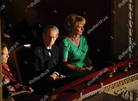 Romania's former King Michael I, center, his daughter Princess Margarita, right, wife Anne de Bourbon Parma, left, are seen before a concert at the National Opera in Bucharest, Romania, occasioned by his 90th birthday
