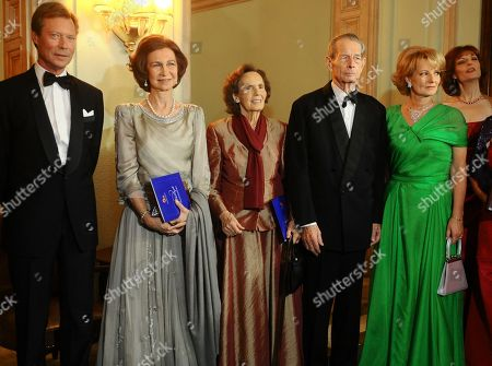 Romania's former King Michael I, second from right, his daughter Princess Margarita, right, wife Anne de Bourbon Parma, center, Queen Sofia of Spain, second from left and Luxembourg's Grand Duke Henri, left, wait before a concert at the National Opera in Bucharest, Romania, occasioned by his 90th birthday