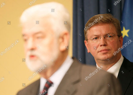 Stefan Fuele, Mirko Cvetkovic European Commissioner for Enlargement and European Neighborhood Policy Stefan Fuele, right, listens Serbian Prime Minister Mirko Cvetkovic, forefround, during a press conference in Belgrade, Serbia, . The European Union will grant Serbia the status of a candidate for membership but will not open formal accession talks until Serbia and Kosovo normalize their ties, diplomats said Wednesday. Serbia has been expected to become a formal candidate for EU membership since the arrest earlier this year of war crimes fugitive Ratko Mladic and his extradition to the international war crimes court