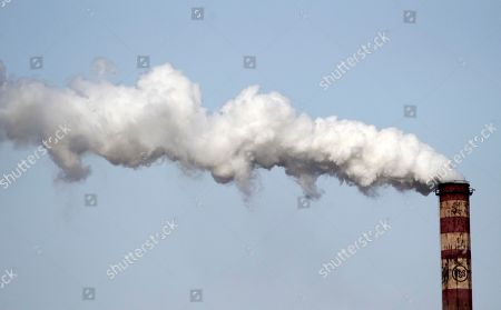 FILE PHOTO Smoke rises from U.S. Steel factory in the city of Smederevo, 45 kilometers east of Belgrade, Serbia. Serbia's government has agreed with U.S. Steel to buy back its loss-making plant in the Balkan country for a symbolic $1, with a goal to avoid its closure and the layoff of 5,400 of its workers, the Prime Minister Mirko Cvetkovic said Friday