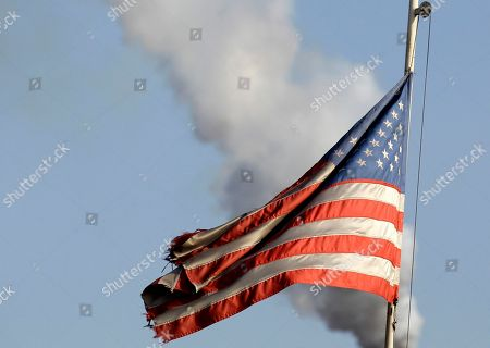 An American flag flies in front of U.S. Steel factory in the city of Smederevo, 45 kilometers east of Belgrade, Serbia. Serbia's government has agreed with U.S. Steel to buy back its loss-making plant in the Balkan country for a symbolic $1, with a goal to avoid its closure and the layoff of 5,400 of its workers, the Prime Minister Mirko Cvetkovic said Friday