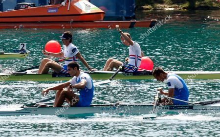 Stock Picture of Peter Chambers, Kieren Emery, Luca De Maria, Armando Dell'Aquila Peter Chambers, right and Kieren Emery of Great Britain celebrate behind Luca De Maria, right, and Armando Dell'Aquila of Italy at the finish line during the final of the Men's Lightweight Pair event at the Rowing World Championships in Bled, Slovenia, . Great Britain won the race in front of second placed Italy and third Germany