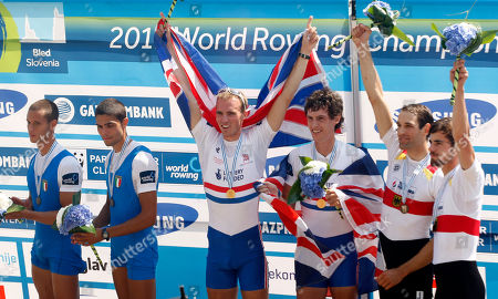 Luca De Maria, Armando Dell'Aquila, Peter Chambers Kieren Emery, Bastian Seibt, Lars Wichert Luca De Maria and Armando Dell'Aquila of Italy Peter Chambers and Kieren Emery of Grat Britain, center and Bastian Seibt and Lars Wichert of Germany, from left, celebrate on the podium of the Men's Lightweight Pair event at the Rowing World Championships in Bled, Slovenia, . Great Britain won the race ahead of second placed Italians and third Germans