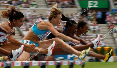 Newsmaker Names From left, Turkey's Nevin Yanit, Kazakhstan's Natalya Ivoninskaya, USA's Kellie Wells and Jamaica's Vonette Dixon compete in a Women's 100m Hurdles at the World Athletics Championships in Daegu, South Korea