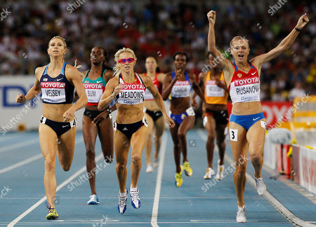 Russia's Yuliya Rusanova, right, reacts as she crosses the finish line ahead of USA's Maggie Vessey, left, and Britain's Jennifer Meadows, center, to win a Women's 800m semifinal at the World Athletics Championships in Daegu, South Korea