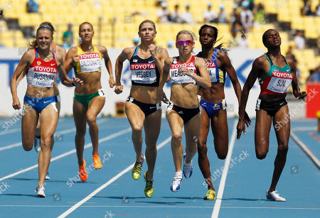Britain's Jennifer Meadows, third from right, crosses the finish line ahead of USA's Maggie Vessey, center, and Colombia's Rosibel Garcia, second from right, in a Women's 800m qualification heat at the World Athletics Championships in Daegu, South Korea