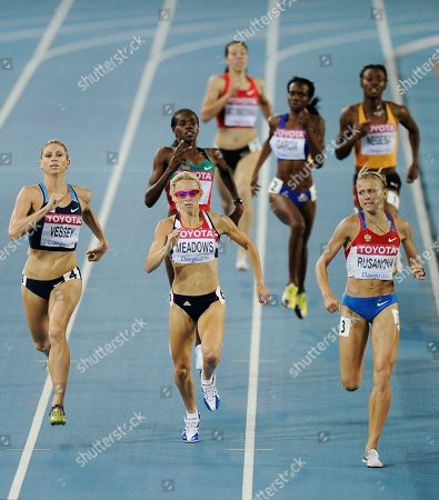 Russia's Yuliya Rusanova, right, Britain's Jennifer Meadows, center, and USA's Maggie Vessey, left, compete in a Women's 800m semifinal at the World Athletics Championships in Daegu, South Korea