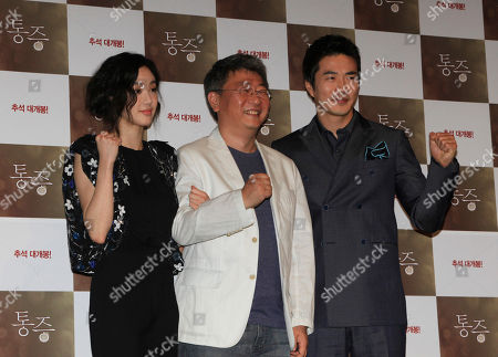 "Stock Image of Jung Ryeo-won, Kwon Sang-woo, Kwak Kyung-taek From left, South Korean actress Jung Ryeo-won, director Kwak Kyung-taek and actor Kwon Sang-woo, pose together during a press conference to promote their latest movie ""Pain"" in Seoul, South Korea"