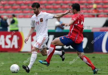 Xabi Alonso Spain's Xabier Alonso, left, controls the ball past Costa Rica's Randall Azofeifa during a friendly soccer match in San Jose, Costa Rica