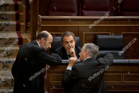 Jose Luis Rodriguez Zapatero, Alfredo Perez Rubalcaba, Jose Blanco Spanish Prime Minister Jose Luis Rodriguez Zapatero, center, talks with Socialist Party presidential candidate Alfredo Perez Rubalcaba, left, and Spain's Government spokesman Jose Blanco, right, during the last session before the election in the Spanish Parliament, Madrid, . Spain's Parliament has reintroduced a wealth tax aimed at deficit-reduction in its last session before dissolving to make way for a general election that opposition conservatives are favored to win
