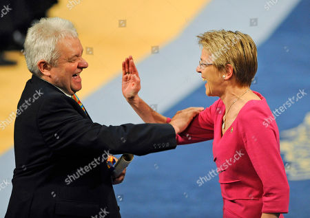 Paul Nurse, Julie Maxton Sir Paul Nurse, left misses a high-five hand clap with Julie Maxton after recieving the Communication and Humanites Prince of Asturias prize in Oviedo, Spain . The award is one of eight of Spain's prestigious Asturias prizes, presented by Crown Prince Felipe and granted each year in various categories