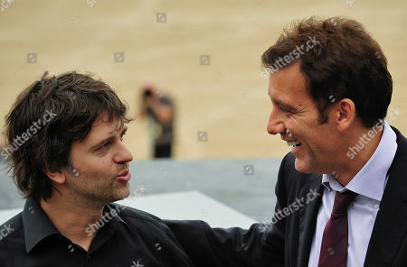 Clive Owen, Juan Carlos Fresnadillo British actor Clive Owen, right, smiles as he talks with Spanish film director, Juan Carlos Fresnadillo during a photo call to promote their film 'Intruders' that is opening the 59th San Sebastian Film Festival Cinema in San Sebastian northern Spain