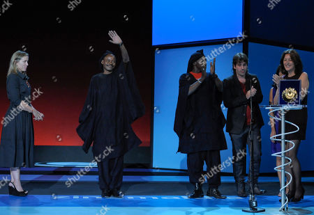 Frances Mcdormand, Amon Pegnere, Amon Pegnere, Isaki Lacuesta, Isa Campo From left, US film director and actress Frances Mcdormand (Official Jury President) looks on as Mali actor Amon Pegnere, Spanish film director Isaki Lacuesta, and Spanish screen writer Isa Campo, accept the Golden Shell award for the best film with 'Los Pasos Dobles' (The Double Steps), at the 59th Film Festival in San Sebastian, northern Spain