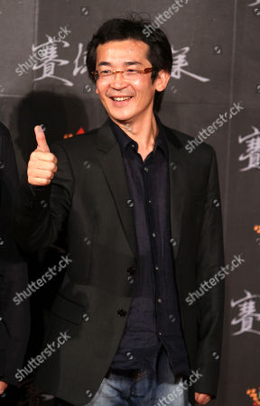 """Wei Te-sheng Taiwanese director Wei Te-sheng gives thumbs-up at a gala premiere for his film """"Warriors of the Rainbow: Seediq Bale"""" in Taipei Taiwan, . The epic about a 1930 aboriginal uprising against Taiwan's Japanese rulers is currently up for best feature film at the Venice Film Festival"""