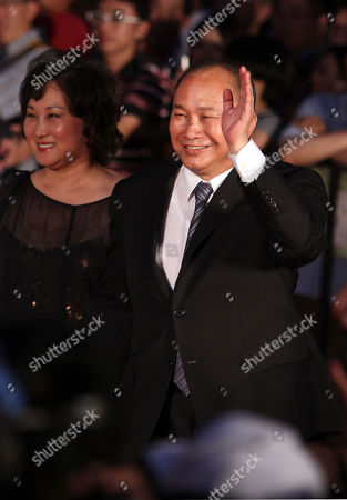 """John Woo Hong Kong director John Woo, right, arrives at a gala premiere for the film """"Warriors of the Rainbow: Seediq Bale"""" directed by Taiwan's Wei Te-sheng in Taipei Taiwan, . The epic about a 1930 aboriginal uprising against Taiwan's Japanese rulers is currently up for best feature film at the Venice Film Festival"""
