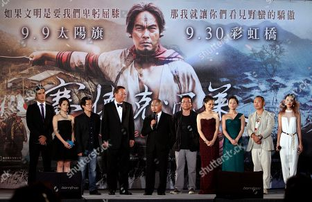 """Wei Te-sheng, John Woo, Vivian Hsu Taiwanese director Wei Te-sheng, third left, Hong Kong director John Woo, fifth left, Taiwanese actress Vivian Hsu, fourth right, and other cast members stand on the stage at a gala premiere for their film """"Warriors of the Rainbow: Seediq Bale"""" directed by Wei in Taipei Taiwan, . The epic about a 1930 aboriginal uprising against Taiwan's Japanese rulers is currently up for best feature film at the Venice Film Festival"""