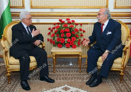 Tunisian President Fouad Mebazaa, right, listens to Palestinian President Mahmoud Abbas during their talks in Tunis, Friday, Nov.11, 2011. Abbas and Fouad Mebazaa are expected to discuss Tunisia's recent elections and the Palestinians' quest for UN membership