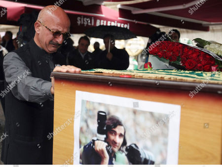 Phyllis Springer French-Iranian photographer Reza Deghati reacts during the funeral of photojournalist Goksin Sipahioglu, who founded the photo agency Sipa, at Tesvikiye Mosque in Istanbul, Turkey, . Sipahioglu was 84 when he died in Paris last week. Born in Turkey, Sipahioglu captured everything from the tense days in Havana during the Cuban Missile Crisis to the French riots of May 1968. In 1973, he and his companion, Springer, founded Sipa, which is named for him. The two married in 2002