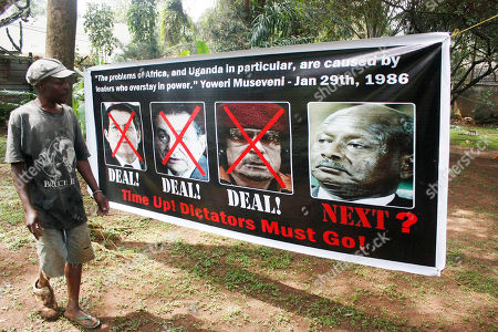 A member of Uganda's opposition ties up a banner in Uganda's capital Kampala, showing former long serving presidents, left to right, Ben Ali (Tunisia), Hosni Mubarak (Egypt), Moummar Gaddafi (Libya) and current Ugandan president Yoweri Museveni in preparation for celebrations for the downfall of these leaders, in Kampala on Friday. Uganda Police has warned that they will arrest whoever turns up for the celebrations. Other long serving African leaders are Mbasago of Equatorial Guinea (32 years since 1979), Jose Santos of Angola (32 years since 1979), Robert Mugabe of Zimbabwe (31 years since 1980), Paul Biya of Cameroon (29 years since 1982), Blaise Campore of Burkina Fasso ( 24 years since 1987), Mswati III of Swaziland (24 years since April 1986), Omar Bashir of Sudan ( 21 years since 1989), Idrissu Deby of Chad ( 21 years since 1990), Isaias Afewerki of Eritrea ( 18 years since 1993), Yahya Jammeh of Gambia (17 years since 1994), Meles Zenawi of Ethiopia (16 years since 1995), Pakalitha Mosisili of Lesotho (13 years since 1998), Ismail Omar Guelleh of Djibouti ( 12 years since 1999), Mohammed VI of Morocco (12 years since 1999), Abdoulaye Wade of Senegal ( 11 years since 2000) and Paul Kagame of Rwanda (11 years since 2000