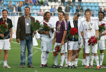 From left to right, Vladimir Smicer of Czech Republic, Ruud Gullit of the Netherlands, Julio Salinas of Spain, Youri Djorkaeff and Mark Keller of France, the Netherlands Frank de Boer, Cameroonian Rigobert Song smile after friendly charitable soccer match between stars of Dynamo Kiev and Legend of Europe teams at the Lobanovskiy stadium in Kiev, Ukraine, Saturday, Sept, 10, 2011