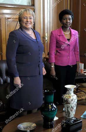 U.N. Women Executive Director, and former President of Chile, Michelle Bachelet, left, stands with Deputy Secretary-General of the United Nations Asha-Rose Migiro at the Legislative Palace in Montevideo, Uruguay