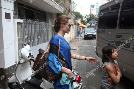 Angelina Jolie, Pax Thien American actress Angelina Jolie, left, and her adopted son Pax Thien leave a Vietnamese restaurant in Ho Chi Minh City, Vietnam, after lunch on . Hollywood power couple Jolie and Brad Pitt and their six children are on a visit to Vietnam, where Pax was born