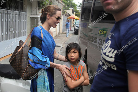 Angelina Jolie, Pax Thien American actress Angelina Jolie, left, and her adopted son Pax Thien get on a minivan to leave a Vietnamese restaurant in Ho Chi Minh City, Vietnam, after lunch on . Hollywood power couple Jolie and Brad Pitt and their six children are on a visit to Vietnam, where Pax was born