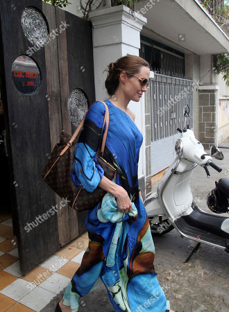 Angelina Jolie American actress Angelina Jolie leaves a Vietnamese restaurant in Ho Chi Minh City, Vietnam, after lunch with her husband Brat Pitt and their children . The Hollywood power couple and their six children are on a visit to Vietnam, where adopted son Pax Thien was born