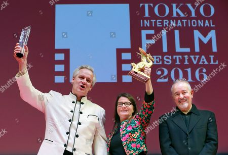 """Chris Kraus, Danny Krausz, Jean-Jacques Beineix Director Chris Kraus, left, of Germany, and producer Danny Krausz celebrate with jury president Jean-Jacques Beineix of France after winning Grand Prix of Tokyo International Film Festival for their film """"The Bloom of Yesterday"""" in Tokyo"""