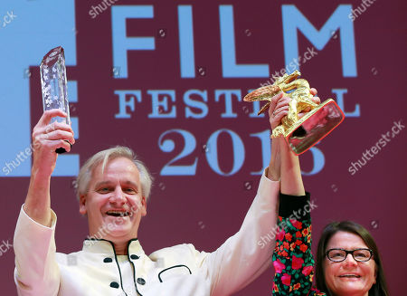 """Chris Kraus, Danny Krausz Director Chris Kraus, left, of Germany, and Producer Danny Krausz celebrate after winning the Grand Prix of Tokyo International Film Festival for their film """"The Bloom of Yesterday"""" in Tokyo"""