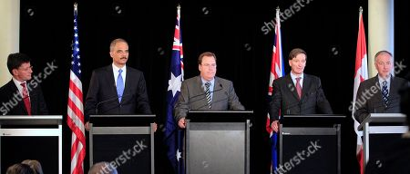 """Chris Finlayson, Eric Holder, Robert McClelland, Dominic Grieve, Rob Nicholson Attorneys-General, from left, New Zealand's Chris Finlayson, U.S. Eric Holder, Australia's Robert McClelland, British Dominic Grieve and Canada's Rob Nicholson attend a briefing for the the third """"Quintet"""" meeting of Attorneys General in Sydney, . The 2011 Quintet meeting will focus on joint and cooperative actions that can be taken to address the growth of international cyber threats"""