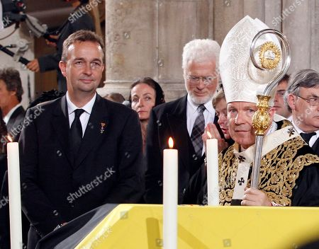 Christoph Schoenborn, Karl von Habsburg Karl von Habsburg, a son of Otto von Habsburg, left, looks on as Austrian Cardinal Christoph Schoenborn,right, blesses the coffin of Otto von Habsburg during the requiem at St. Stephen's Cathedral in Vienna, Austria, on . The oldest son of Austria-Hungary's last emperor and longtime head of one of Europe's most influential families has died at age 98 on July 4