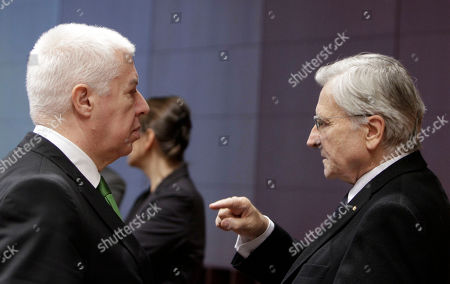 Jean-Claude Trichet, Fernando Teixeira Dos Santos European Central Bank President Jean-Claude Trichet, right, speaks with Portuguese Finance Minister Fernando Teixeira Dos Santos during a round table meeting of eurogroup finance ministers at the EU Council building in Brussels, . Greece's debt rating is slashed to the lowest of any country in the world, leaving a nation that uses the euro and is backed by the European Central Bank less credit-worthy than Pakistan. The prospect of a default that would rock global markets looms large as EU finance ministers meet in Brussels to discuss how much the private sector should pitch in