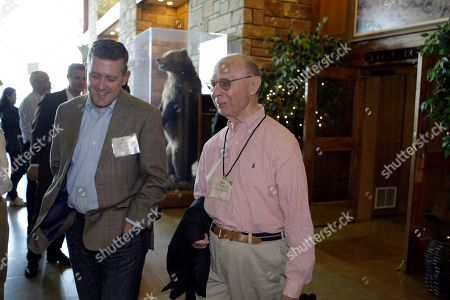 James Bullard, president of the Federal Reserve Bank of St. Louis, left, and Allan H. Meltzer, professor at Carnegie Mellon University, at the lunch break of the Economic Policy Symposium at Jackson Hole in Moran, Wyo